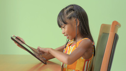 Young Asian Girl Enjoying Playing on an iPad Footage