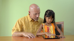 Daughter and Father Playing on a Tablet Computer T Stock Video Footage