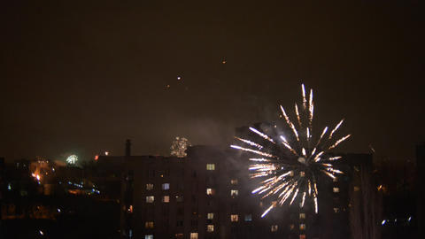 Happy New Year fireworks, night town Stock Video Footage