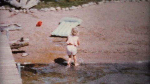 Little Girl Playing In Sand At The Beach 1962 Stock Video Footage
