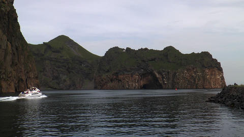 boat passing rocks at westman islands in iceland Footage