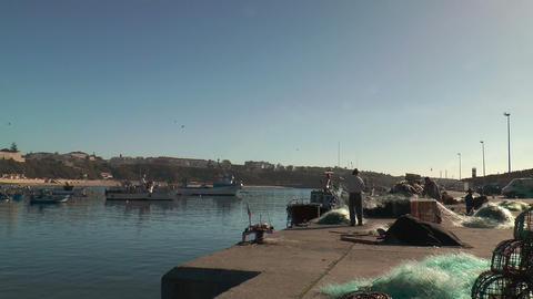 fishermen preparing net wide angle shot Stock Video Footage