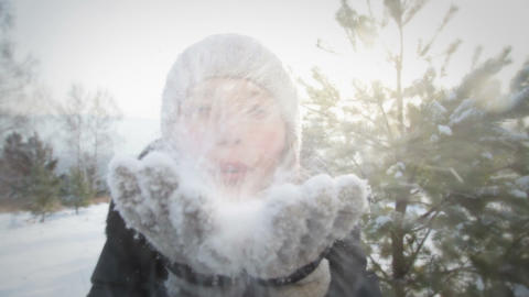 Young Woman Blows Snowflakes Footage