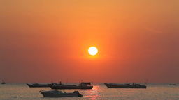 Boats in Ocean at Sunset Footage