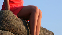 Woman Sitting on Rock Footage