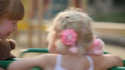 Little Girls on Carousel Footage