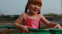 Girl On Carousel stock footage