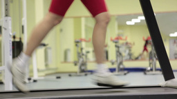Female Legs Running on the Treadmill Footage