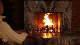 Man Relaxing in Front of Fireplace Footage