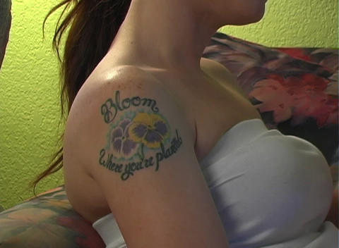 Beautiful, Sexy Brunette with Tattoos Relaxes with Stock Video Footage