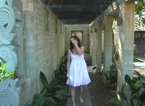 Beautiful, Sexy Brunette in a Covered Walkway (1) Stock Video Footage