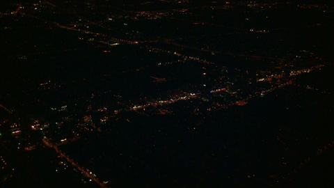City scenic at night from above the clouds (High Definition) Footage