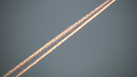 Condensation trails left behind from a passing airplane... Stock Video Footage