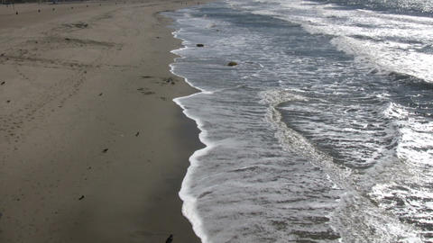 Waves gently flow over shore in beach scenic (High Definition) Footage