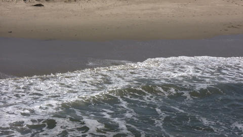 Waves gently flow over shore in beach scenic (High... Stock Video Footage