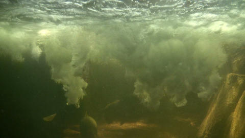 Underwater shot below a small waterfall Footage