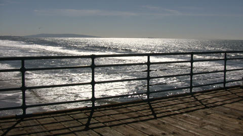 Ocean sparkles and moves from beyond the boardwalk (High... Stock Video Footage