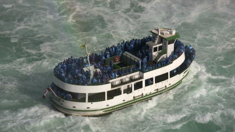 Tourists stand on tour boat near Niagara Falls (High... Stock Video Footage