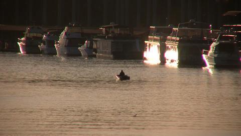 Small boat floats in water during sunset Stock Video Footage