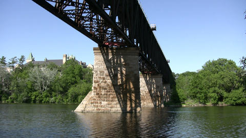 Steel train bridge crosses over the river (High Definition) Stock Video Footage