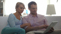 Husband and Wife Using Laptop Footage