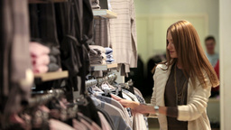Girl Choosing Clothes stock footage