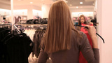 Girl trying a dress on Footage