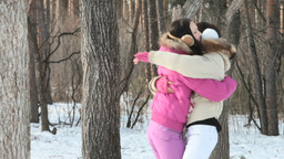 Girls playing in winter forest Footage