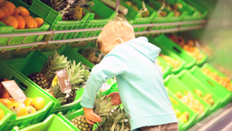 Little boy with pineapple Footage