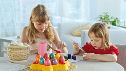 Girls Painting Eggs For Easter Footage