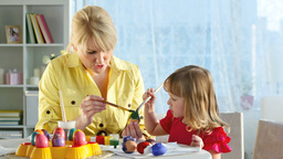 Mother And Daughter Painting Eggs Footage