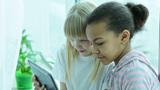 Schoolgirls Using Digital Tablet Footage