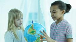 Schoolgirls Spinning Globe Footage