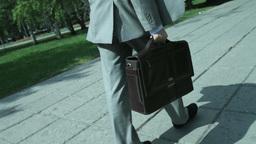 Businessman Walking Along Street Footage