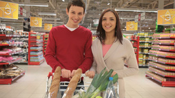 Couple Pushing a Shopping Cart Footage