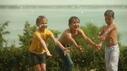 Children Enjoying Sprinkled Water Footage