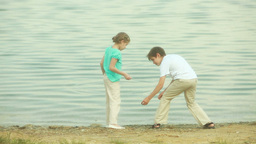 Children Skipping Stones In Lake stock footage