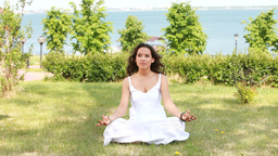 Young Beautiful Woman Meditating Footage