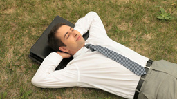 Businessman Sleeping In Lawn Footage
