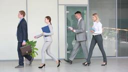 Business People Walking In Corridor Of Office Footage