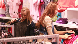 Attractive Female Friends Shopping In Mall Footage