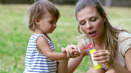 Mother And Daughter Blowing Bubbles Footage