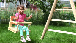 Cheerful Girl Swinging Footage