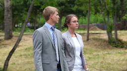 Business Couple Walking In Park Footage