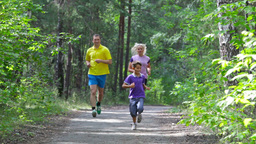Competitive Lad Outrunning His Parents On A Family Jog Footage