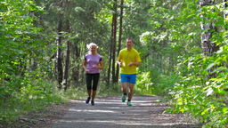 Man And Woman Running In The Park Enhancing Endurance Footage