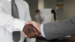 Close-Up Of Business Partners Greeting Each Other With A Firm Handshake Footage