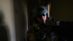 Group Of Soldiers Running Through Dark Basement Of A Derelict Building Footage