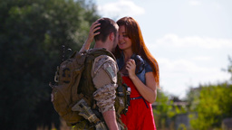 Young Man Coming Home From Army Welcomed By His Pretty Girlfriend Footage