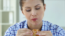Lovely Young Woman Taking A Bite Of A Cheeseburger Footage